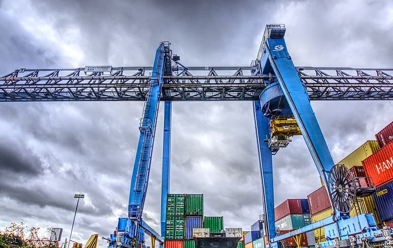 Blue and gray crane under cloudy sky during daytime