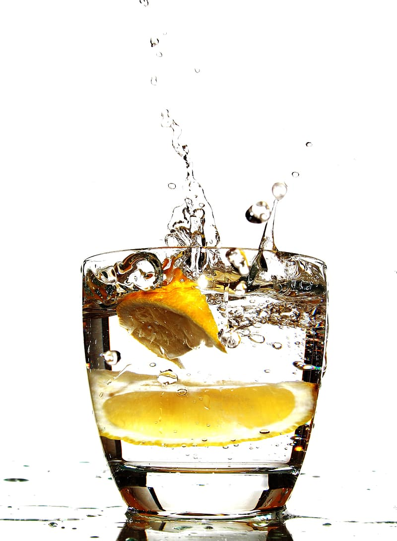 Clear drinking glass with lemon inside