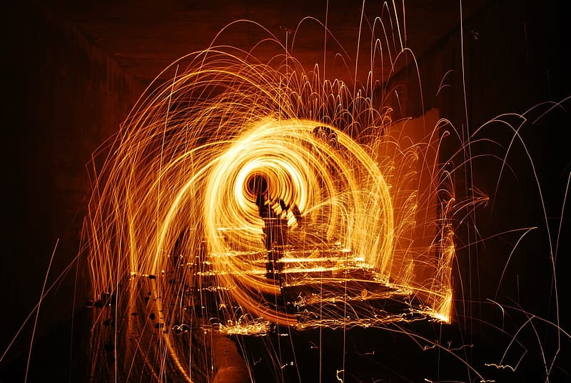 Steel wool photography of man in black shirt