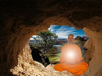 Edited photo of monk inside the cave during daytime