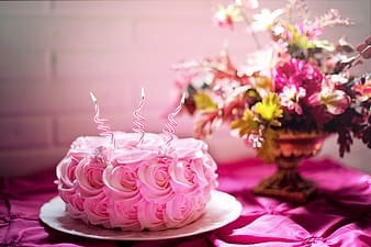 Pink icing covered cake on white plate