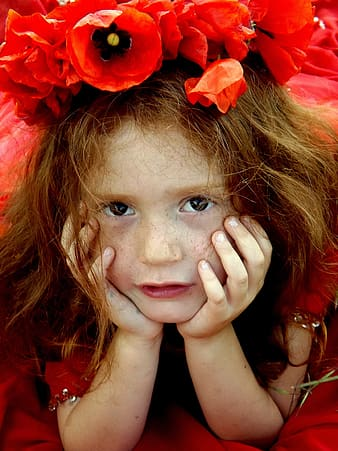 Photo of a girl with red flowers