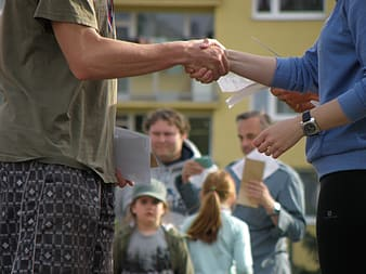 Selective focus photography of two person shaking hands