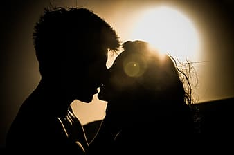 Silhouette photo of kissing couple