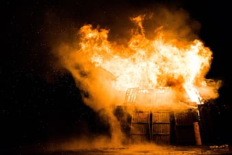 Photography of burning house at nighttime