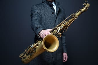 Person holding saxophone