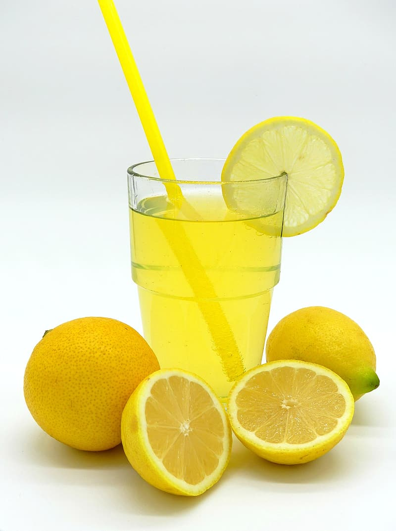 Clear glass cup filled with lemon juice