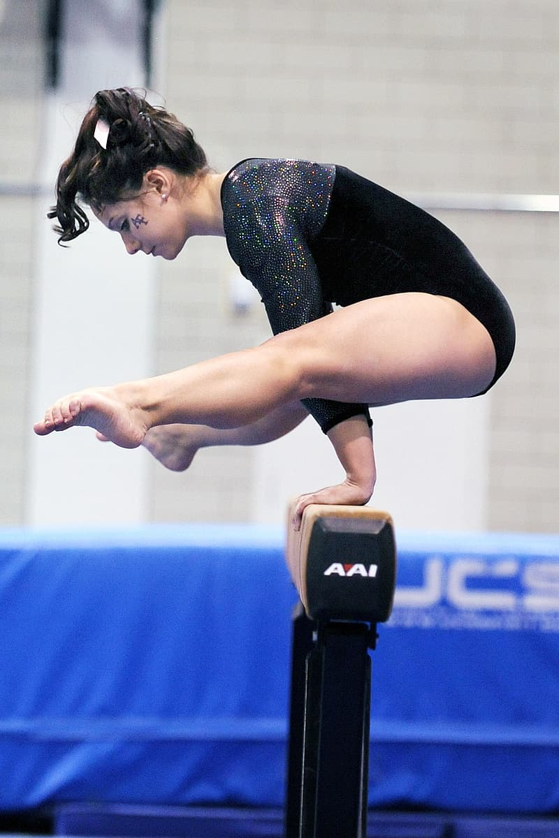 Woman wearing black leotards