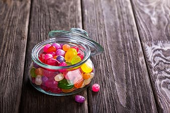 Jellies in clear glass container with lid