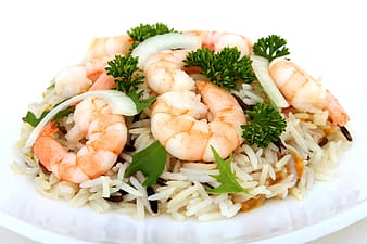 Plate of cooked white rice with shrimps