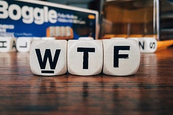 WTF word boggle blocks on brown wooden surface