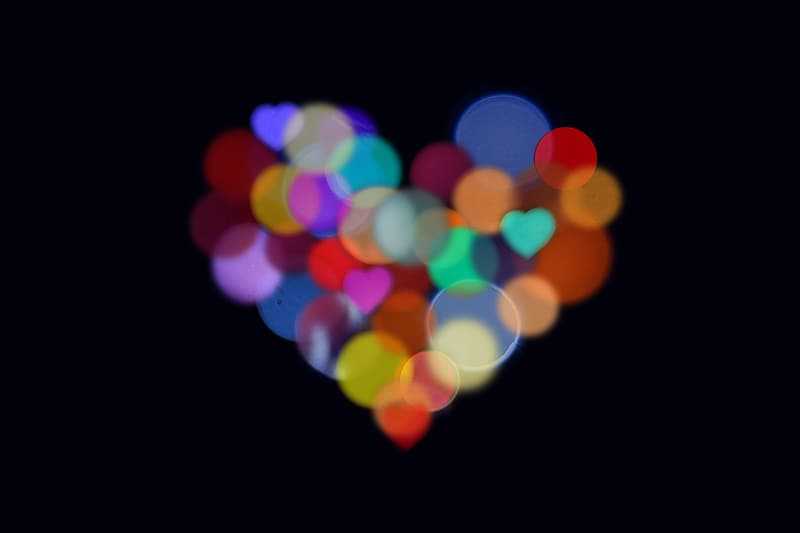 Multicolored heart bokeh light wallpaper