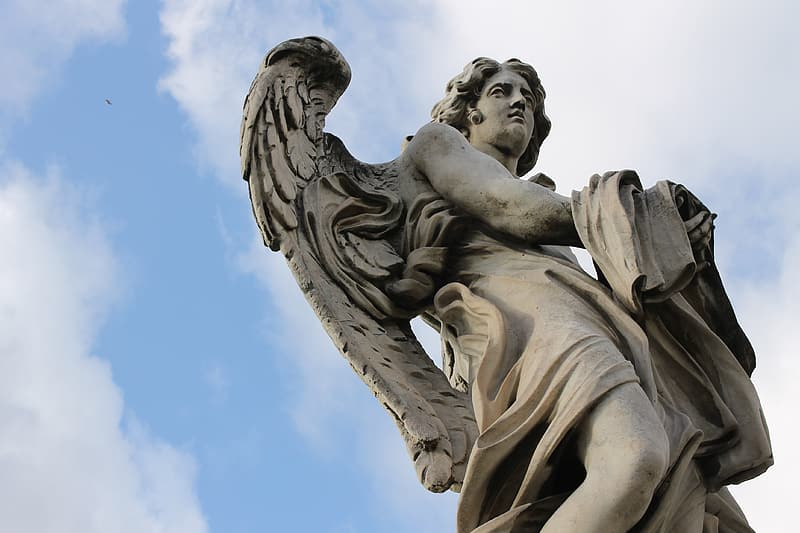 Low-angle view of angel statue