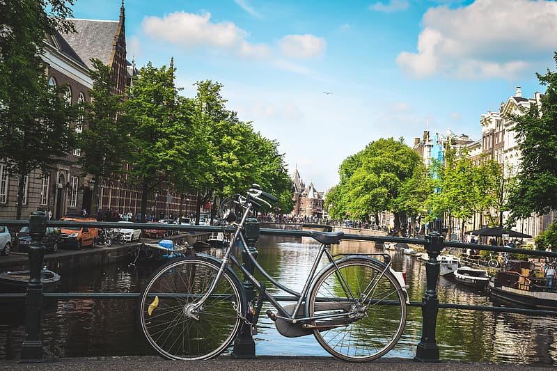 Bicycle by a canal in Amsterdam, Holland