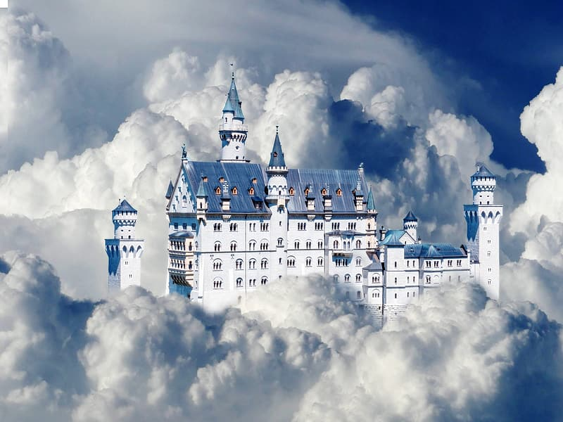 White and blue castle surrounded by clouds