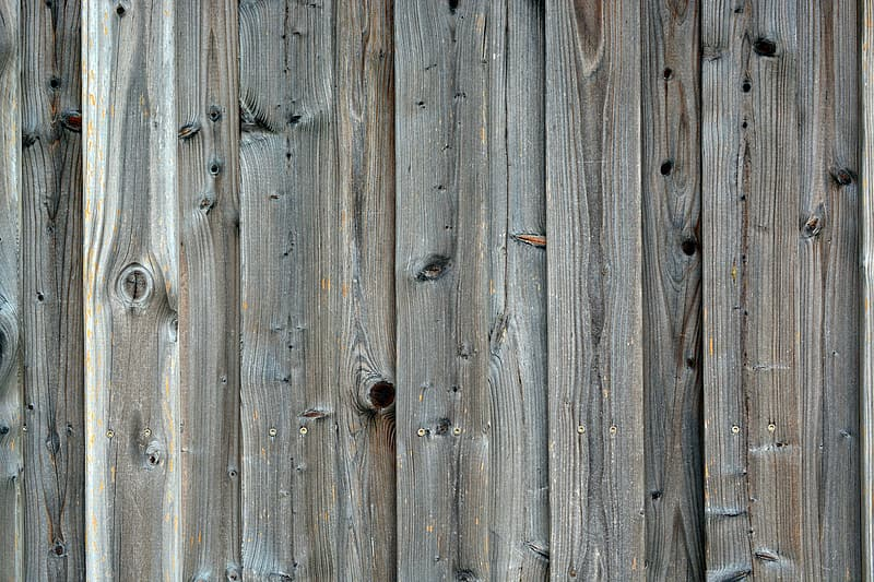 Brown wooden fence with hole