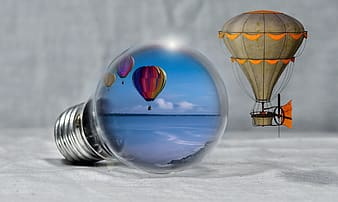 Hot air balloons displaying in light bulb