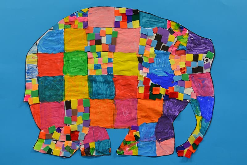 Yellow and blue elephant cutout artwork with blue background