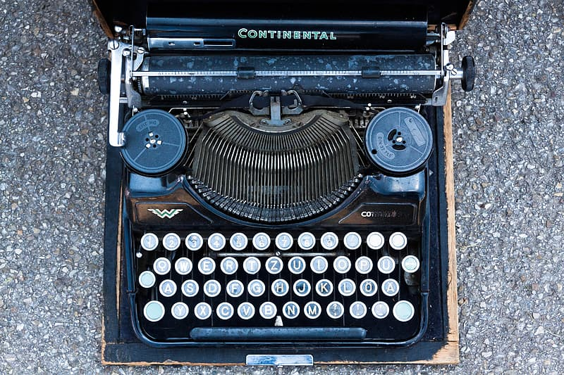 Top-view photography of black Continental typewriter