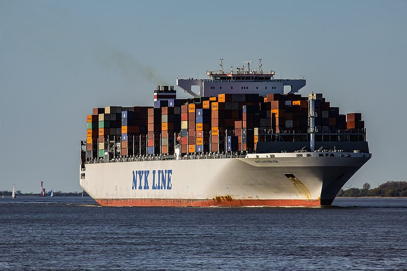 White cargo ship in body of water