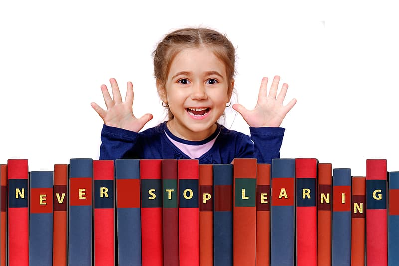 Girl standing in front of row books