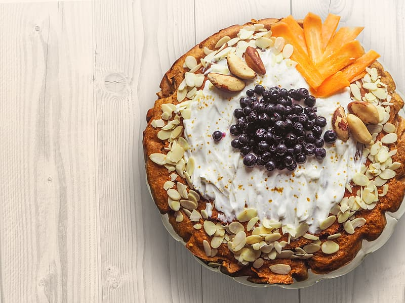 Cake with nuts and whip cream