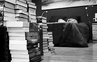 Assorted books near bed