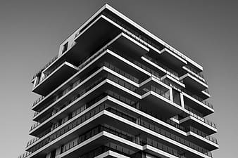 Gray high rise building in low angle photography