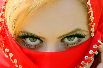 Woman covering her face with red textile