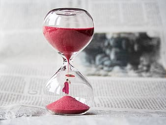 Photo of red sand glass hour