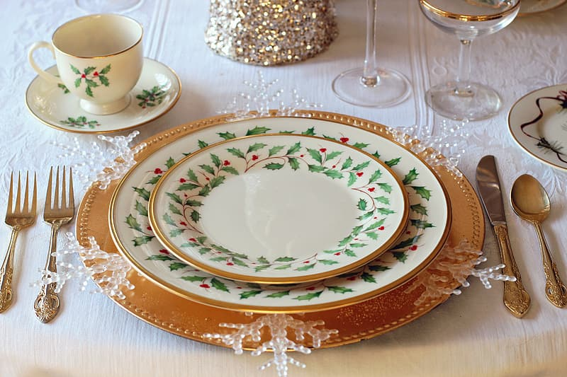 White ceramic dining plates and spoon and forks