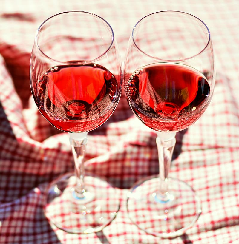 Two wine glasses filled with red wine