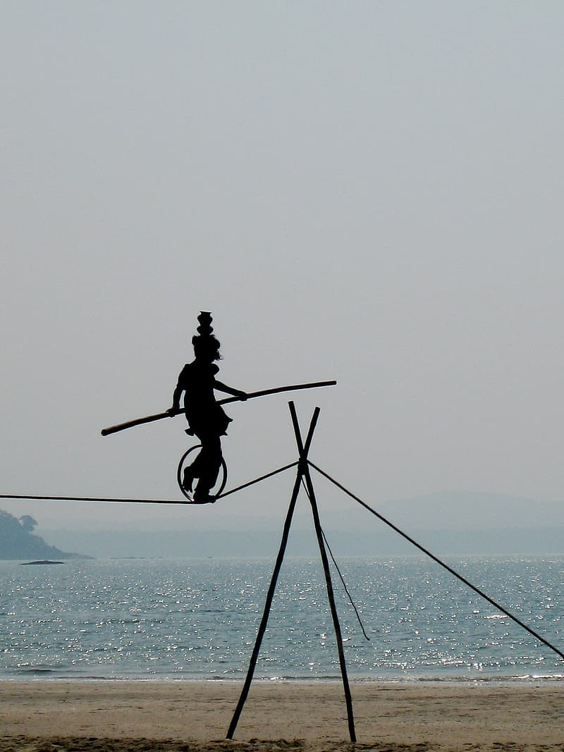 Silhouette photography of rope balancer