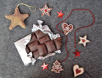 Brown chocolate bar on red and yellow star print textile