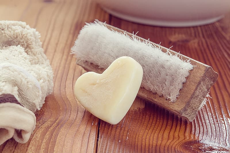 White heart soap near brown brush