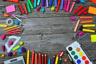 Multi color coloring pencils on brown wooden table