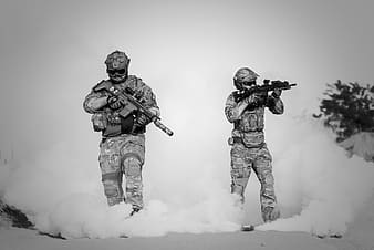 Two soldiers holding rifles