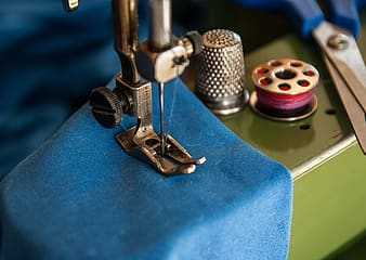 Shallow focus of sewing machine with blue textile