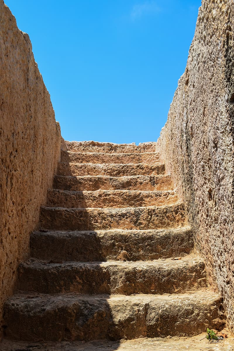 Brown stone staircase under clear blue sky