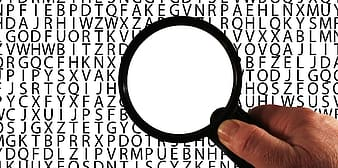 Person holding magnifier