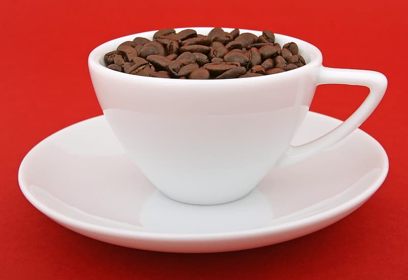 Teacup filled with coffee beans
