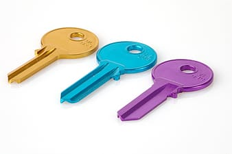 Three gold, blue, and purple keys
