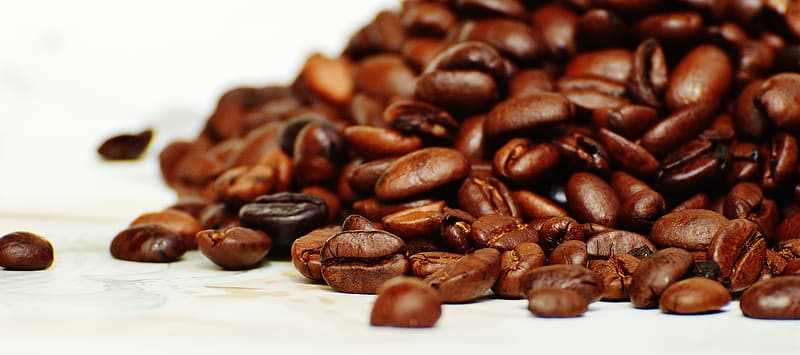 Coffee beans on white surface