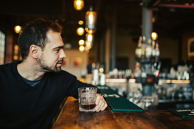 Handsome young man in a pub