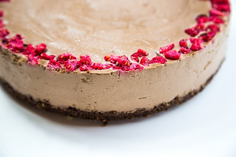 Brown and pink cake on white surface