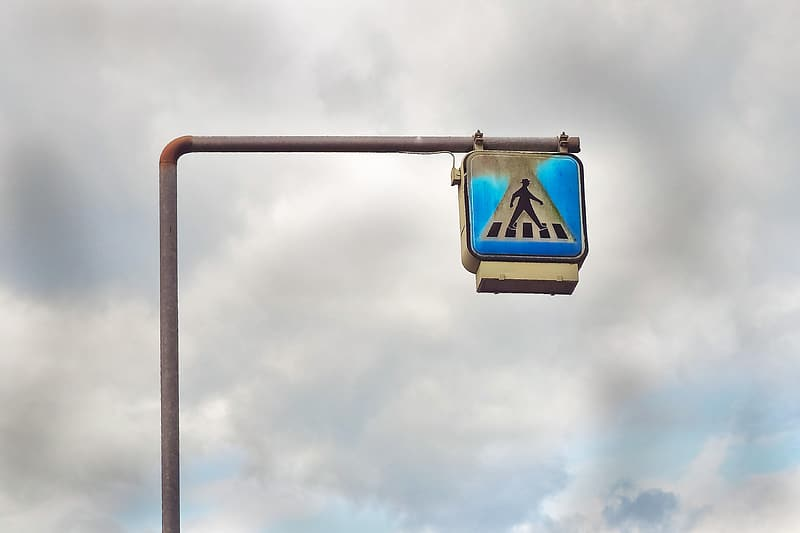 Black and white pedestrian sign