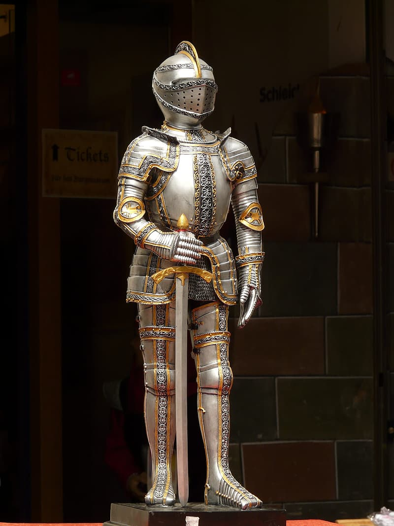 Silver knight statue holding a sword