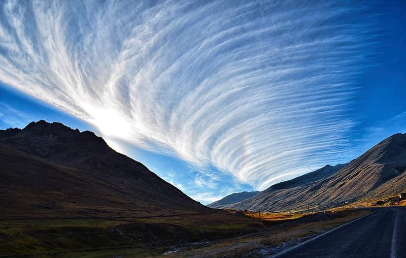 Photo of mountain with stratus cloud