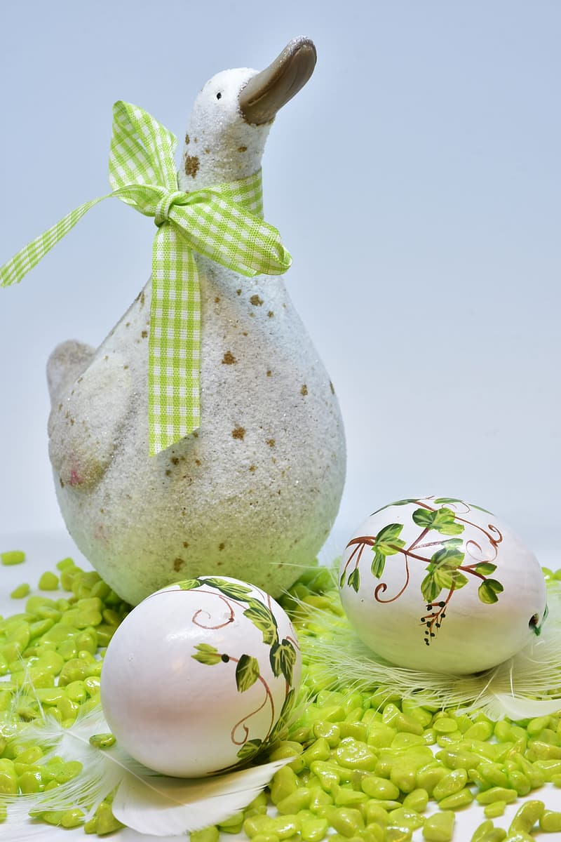 Gray and white egg with green and white ribbon