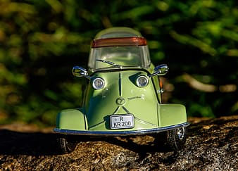 Green coupe die-cast model toy photograph